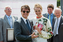 © Licensed to London News Pictures. 31/07/2014. Chichester, UK Hollywood actor Tom Cruise with  supermodel Edie Campbell after she wins first place in the Ladies Race.  Ladies Day at Glorious Goodwood at Goodwood racecourse in Chichester today 31/07/14. Photo credit : Stephen Simpson/LNP