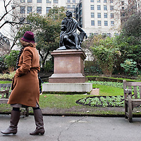LONDON, ENGLAND - JANUARY 23: A woman walks past the statue of Scottish poet Rober Burns in Central London on January 23, 2010 in London, England. Scots across the world annually celebrate on January 25th the life of Robert Burns, the country's most famous bard, with recitations of his poetry, the eating of haggis and imbibing of whisky.  (Photo by Marco Secchi/Getty Images)
