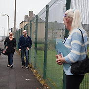Kelly McDonald, a YES campaigner, greets new voters.<br />
