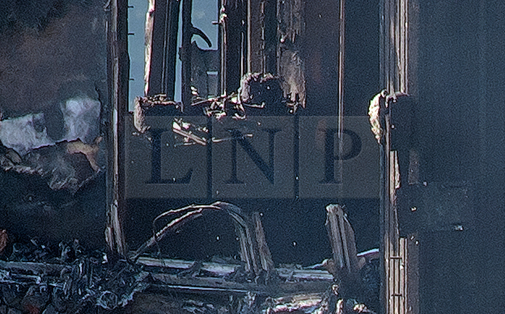 © Licensed to London News Pictures. 15/06/2017. London, UK. The burnt out remains of the inside of some of the apartments can be seen the Grenfell tower block in west London. The blaze engulfed the 27-storey building with hundreds of firefighters attending the scene. Photo credit: Ben Cawthra/LNP