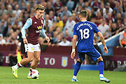 Aston Villa midfielder Jack Grealish (10) looks to release the ball  under pressure from Everton midfielder Morgan Schneiderin (18) during the Premier League match between Aston Villa and Everton at Villa Park, Birmingham, England on 23 August 2019.