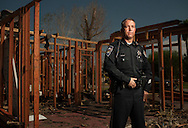 While on patrol, Nevada State Trooper Robert Borchardt saw smoke rising from a nearby home.  The fire quickly spread while he barely had time to save four teenagers from the burning home.