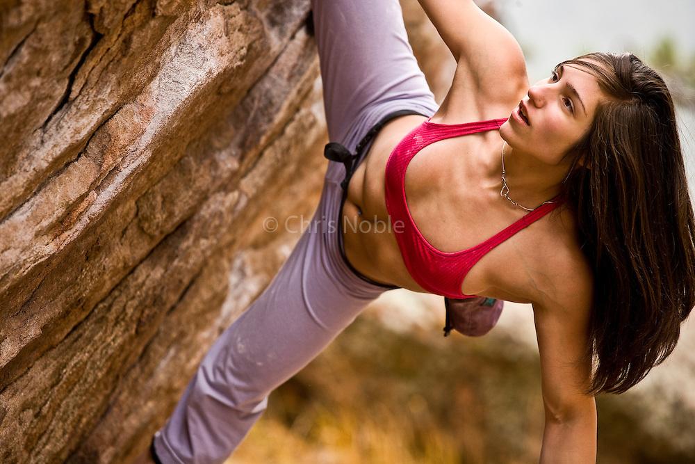 Bouldering competitor Alex Puccio bouldering on Flagstaff Mountain near her home town of Boulder Colorado.