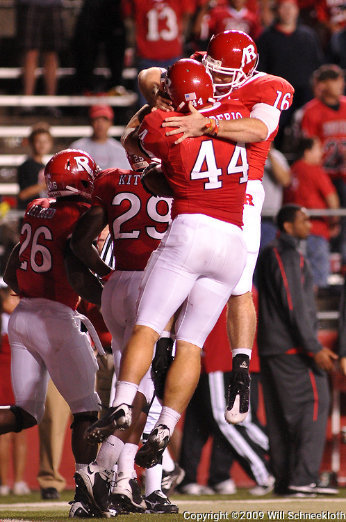 Sep 19, 2009; Piscataway, NJ, USA; Rutgers wide receiver Andrew DePaola (16) celebrates linebacker Ryan D'Imperio's (44) interception return for a touchdown during the second half of Rutgers' 23-15 victory over Florida International at Rutgers Stadium.