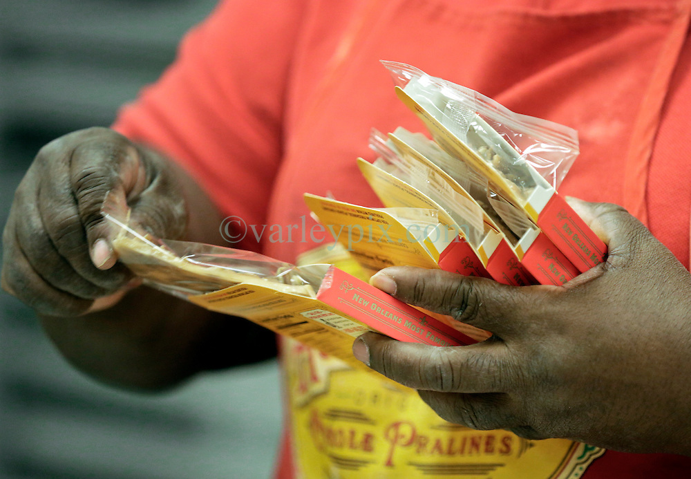 21 September 2015. New Orleans, Louisiana.<br /> Ms Viola Smothers packs Aunt Sally's Pralines.<br /> Photo©; Charlie Varley/varleypix.com