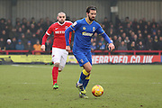 AFC Wimbledon defender George Francomb (7) dribbling and being chased by Charlton Athletic striker Tony Watt (7) during the EFL Sky Bet League 1 match between AFC Wimbledon and Charlton Athletic at the Cherry Red Records Stadium, Kingston, England on 11 February 2017. Photo by Matthew Redman.