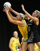 Australia's Cath Cox. left, and New Zealand's Casey Williams compete for the ball in the New World Quad series netball match, Claudelands Arena, Hamilton, New Zealand, Thursday, November 01, 2012. Credit:NINZ/ Dianne Manson.