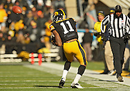 November 23 2013: Iowa Hawkeyes wide receiver Kevonte Martin-Manley (11) pulls in a catch during the first quarter of the NCAA football game between the Michigan Wolverines and the Iowa Hawkeyes at Kinnick Stadium in Iowa City, Iowa on November 23, 2013. Iowa defeated Michigan 24-21.