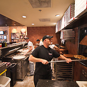 12/17/10 Wilmington DE: Kitchen Manager Scott Kujolie (Right) and  Kitchen Staff working very hard to get food out to waiting customers at Anthony's Coal Fired Pizzas in Wilmington Delaware...Special to The News Journal/SAQUAN STIMPSON