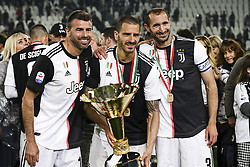 May 19, 2019 - Turin, Italy - BBC Juventus defender Andrea Barzagli (15), Juventus defender Leonardo Bonucci (19) and Juventus defender Giorgio Chiellini (3) celebrate victory of italian Serie A championship after the Serie A football match n.37 JUVENTUS - ATALANTA on 19/05/2019 at the Allianz Stadium in Turin, Italy. (Credit Image: © Matteo Bottanelli/NurPhoto via ZUMA Press)