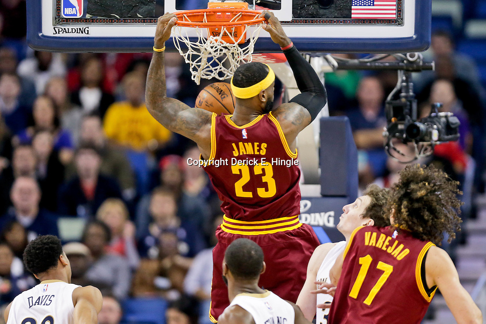 Dec 12, 2014; New Orleans, LA, USA; Cleveland Cavaliers forward LeBron James (23) dunks against the New Orleans Pelicans during the first quarter of a game at the Smoothie King Center. Mandatory Credit: Derick E. Hingle-USA TODAY Sports