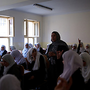 November 11, 2012 - Kabul, Afghanistan: Ninth grade female students attend geography classes at Shirino High School in Kabul...After decades without access to education under the Taliban regime, and despite the still existent social stigmas, female students make now 40 per cent of the over all students in the country. (Paulo Nunes dos Santos/Polaris)