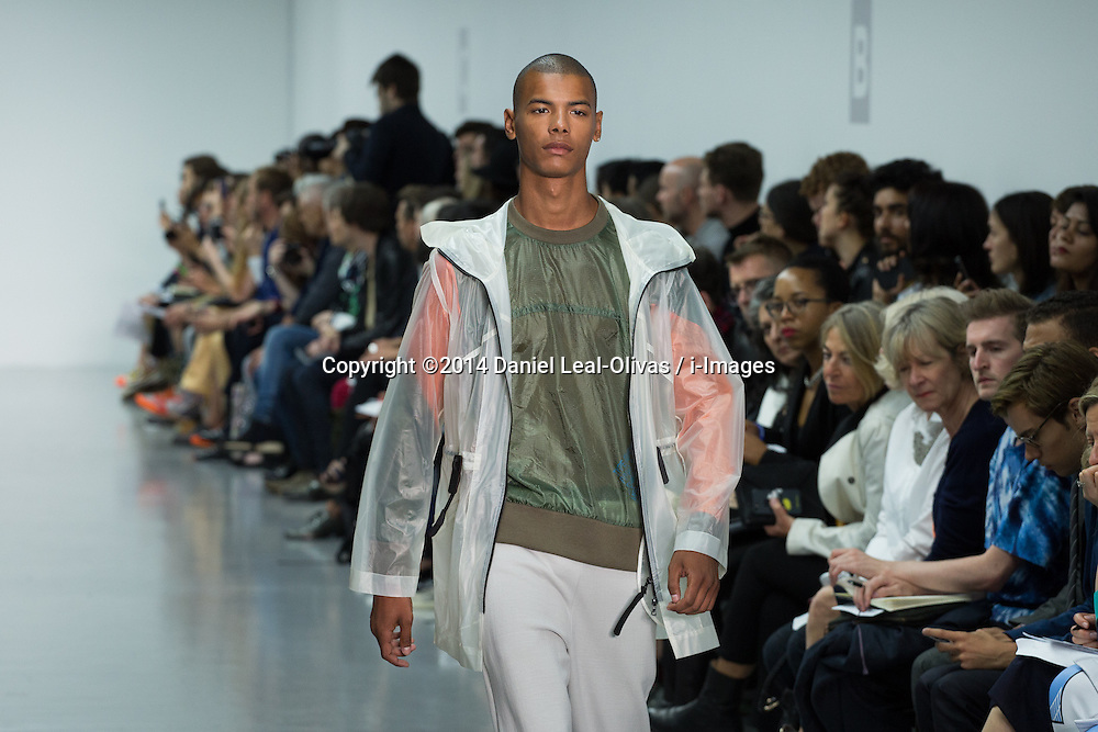 Image ©Licensed to i-Images Picture Agency. 15/06/2014. London, United Kingdom. London Collections: Men. A model presents a creation by Christopher Raeburn during the first day of the Spring/Summer 2015 \'London Collections: Men\' fashion event in London. The Old Shorting Office. Picture by Daniel Leal-Olivas / i-Images