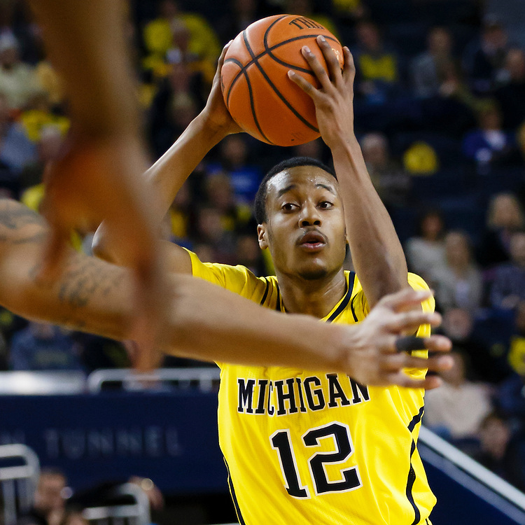 Feb 22, 2015; Ann Arbor, MI, USA; Michigan Wolverines guard Muhammad-Ali Abdur-Rahkman (12) looks to pass in the first half against the Ohio State Buckeyes at Crisler Center. Mandatory Credit: Rick Osentoski-USA TODAY Sports