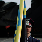 An Ukrainian policeman holds the flag of Donbass region, during a ceremony that marks 69 years since the Soviets defeated the Nazis, at the War Memorial in central Donetsk, amid tensions over the referendum for autonomy of the region to be held over the weekend.