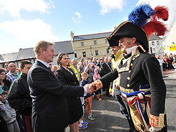 An Taoiseach Enda Kenny TD and Aurelie Bonal First Consul from the French Embassy exchange greetings with Stephen Dunford and Gerald Clamens after the 'Races of Castlebar' Re-enactment at the In Humberts Footsteps' Gathering event that took place in the town on sunday.<br /> Pic Conor McKeown