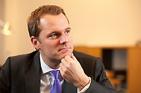 24 NOV 2010, BERLIN/GERMANY:<br /> Daniel Bahr, FDP, Parl. Staatssekretaer im Bundesministerium fuer Gesundheit, waehrend einem Interview, in seinem Buero, Bundesministerium fuer Gesundheit<br /> IMAGE: 20101124-01-046