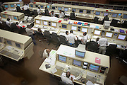 European Space Agency technicians at Ariane launch control monitor rocket systems hours before a satellite launch