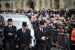 © Licensed to London News Pictures. 31/03/2018. Cambridge, UK. The procession arrives at the church. The funeral of Stephen Hawking at Church of St Mary the Great in Cambridge, Cambridgeshire. Professor Hawking, who was famous for ground-breaking work on singularities and black hole mechanics, suffered from motor neurone disease from the age of 21. He died at his Cambridge home in the morning of 14 March 2018, at the age of 76. Photo credit: Ben Cawthra/LNP
