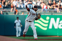 SAN FRANCISCO, CA - JUNE 12: Brandon Crawford #35 of the San Francisco Giants throws to first base against the San Diego Padres during the first inning at Oracle Park on June 12, 2019 in San Francisco, California. The San Francisco Giants defeated the San Diego Padres 4-2. (Photo by Jason O. Watson/Getty Images) *** Local Caption *** Brandon Crawford