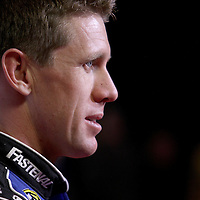Driver Carl Edwards speaks with the media during the NASCAR Media Day event at Daytona International Speedway on Thursday, February 14, 2013 in Daytona Beach, Florida.  (AP Photo/Alex Menendez)