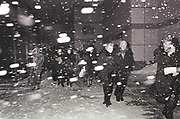 Guests  brave the elements as they arrive at a gala at Alice Tully Hall attended by Hillary Rodham Clinton. New York. 21 February 1993. Film 93197f20