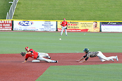 29 July 2016: Ty Morris does a head first dive to 2nd base and safely makes it when the ball bounds away from Eric Grabe during a Frontier League Baseball game between the Lake Erie Crushers and the Normal CornBelters at Corn Crib Stadium on the campus of Heartland Community College in Normal Illinois