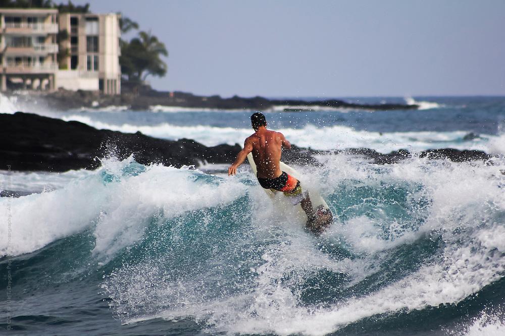 candid capture of surfer captured off the coast of Kona Reef, Hawaii