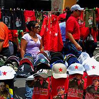 VENEZUELAN POLITICS / POLITICA EN VENEZUELA<br /> Seller of shirts and caps of political slogans / Vendedor de camisas y gorras de consignas politicas<br /> Caracas - Venezuela 2009<br /> (Copyright © Aaron Sosa)