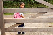 Santos Dumont_MG, Brasil...Estudante esperando o onibus escolar proxima a uma porteira...The student waiting a school bus  next to a portress...Foto: LEO DRUMOND / NITRO