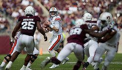 Auburn quarterback Jarrett Stidham (8) looks to pass against Texas A&M during the first quarter of an NCAA college football game on Saturday, Nov. 4, 2017, in College Station, Texas. (AP Photo/Sam Craft)