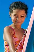 Cute girl with boggieboard at the beach. Cape Cod, MA