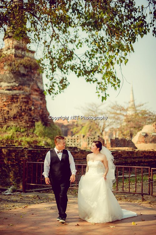 Ayutthaya Thailand - Yoko and Tor's prewedding (prenuptial, engagement session) at Wat Phra Si Sanphet in Ayutthaya, Thailand.<br /> <br /> Photo by NET-Photography<br /> Ayutthaya Thailand Wedding Photographer<br /> info@net-photography.com<br /> <br /> View this album on our website at http://thailand-wedding-photographer.com/pre-wedding-ayutthaya-mae-klong-market/?utm_source=photoshelter&amp;utm_medium=link&amp;utm_campaign=photoshelter_photo