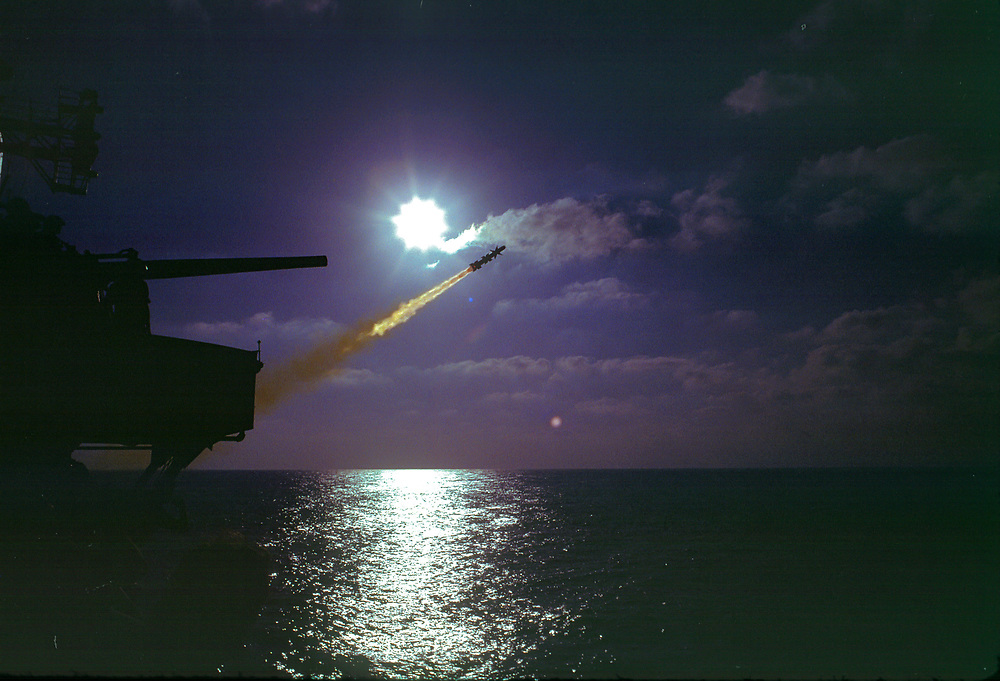 Talos Missile Shot, Forward Launcher, USS Chicago, CG-11. Backlit by evening sun