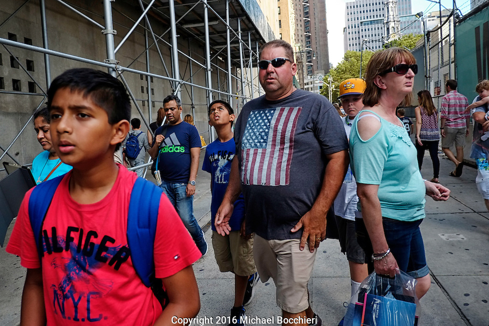 NEW YORK, NY - August 06:  People walk around the World Trade Center on August 06, 2016 in NEW YORK, NY.  (Photo by Michael Bocchieri/Bocchieri Archive)