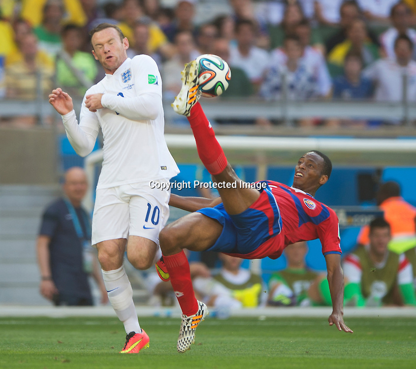 Wayne Rooney goes for an aerial ball with Junior Diaz<br /> <br /> Costa Rica v England - World Cup Group D - Stadio Mineirao - Belo Horizonte<br /> <br /> Picture : Mark Pain/Offside<br /> 24/6/2014