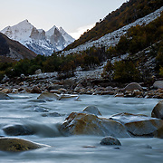 The Bhagirathi peaks rise above the Ganges (Bhagirathi) River from Chirbhasa, Garhwal Himalaya, Uttarkhand, India.