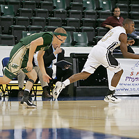 Knights Guard Andre Wooten (13) on a break away with Flyers Guard Will Spitzfaden (4) in pursuit.