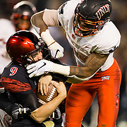 10 November 2018: San Diego State Aztecs quarterback Ryan Agnew (9) takes a shot to the head from a UNLV defender while trying to scramble for a first down in the second quarter. The Aztecs lost 27-24 to UNLV Saturday night at SDCCU Stadium falling a game behind Fresno State in the conference standings.