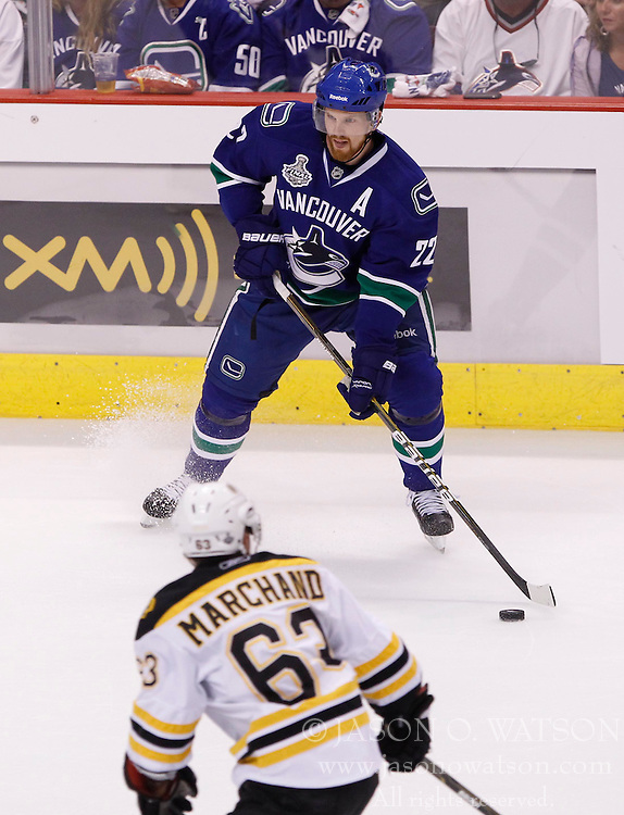 June 4, 2011; Vancouver, BC, CANADA; Vancouver Canucks left wing Daniel Sedin (22) looks to pass against Boston Bruins left wing Brad Marchand (63)  during game two of the 2011 Stanley Cup Finals at Rogers Arena. The Canucks won 3-2 in overtime. Mandatory Credit: Jason O. Watson / US PRESSWIRE