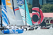 Practice racing for the first of the Extreme Sailing Series regattas being sailed in Singapore. 19/2/2014