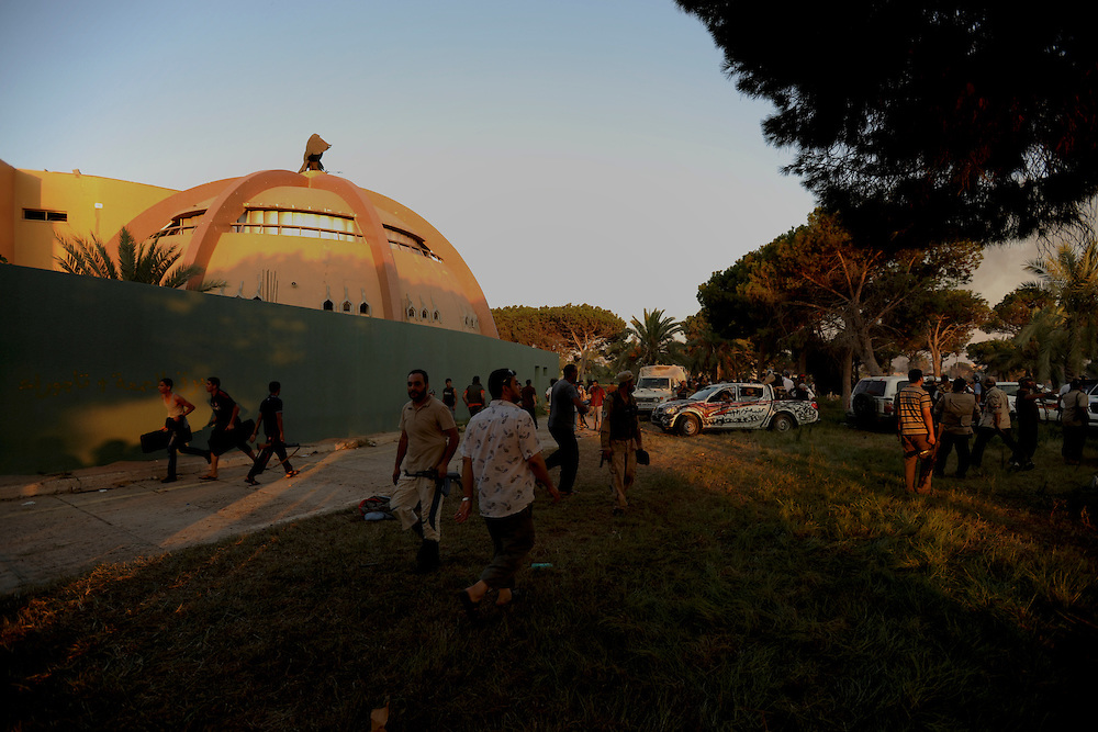 Rebel fighters and local residents gather at the gardens of Muammar Gaddafi's Bab Al Azizia compound in Tripoli.