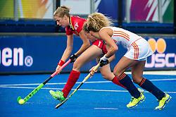 Belgium's Anouk Raes is watched by The Netherlands Maria Verschoor. The Netherlands v Belgium - Unibet EuroHockey Championships, Lee Valley Hockey & Tennis Centre, London, UK on 26 August 2015. Photo: Simon Parker