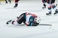 KELOWNA, CANADA - JANUARY 26: Liam Kindree #26 of the Kelowna Rockets lies on the ice after colliding with a player against the Vancouver Giants on January 26, 2019 at Prospera Place in Kelowna, British Columbia, Canada.  (Photo by Marissa Baecker/Shoot the Breeze)