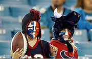 Houston Texans fans with painted faces look for an autograph before the NFL week 14 football game against the Jacksonville Jaguars on Thursday, Dec. 5, 2013 in Jacksonville, Fla. The Jaguars won the game 27-20. ©Paul Anthony Spinelli