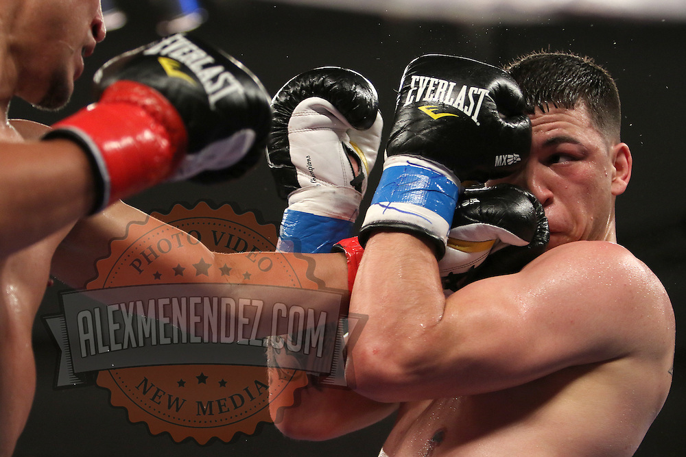 KISSIMMEE, FL - MARCH 06:  Charles Natal (R) attempts to block a punch by Juan Aguirre during the Telemundo Boxeo boxing match at the Kissimmee Civic Center on March 6, 2015 in Kissimmee, Florida. (Photo by Alex Menendez/Getty Images) *** Local Caption ***  Charles Natal; Juan Aguirre