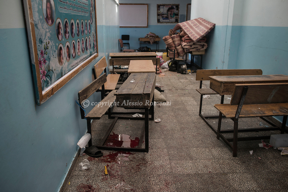 Gaza Strip, Beith Hanoun: Blood stains of displaced Palestinians are seen inside the UNRWA school in Beit Hanoun after it has been stroked. The explosion killed at least 10 people and wounded dozens. ALESSIO ROMENZI