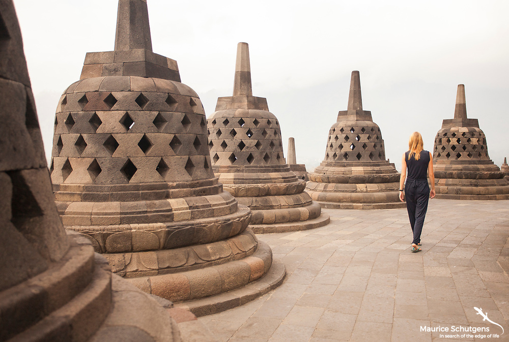 Strolling through the spectacular Borobudur temple on Java Island.