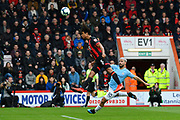 Nathan Ake (5) of AFC Bournemouth heads the ball behind to prevent Sergio Aguero (10) of Manchester City getting on the end of it during the Premier League match between Bournemouth and Manchester City at the Vitality Stadium, Bournemouth, England on 2 March 2019.