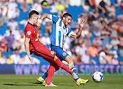 Brighton striker Tomer Hemed and Blackburn Rovers player Tom Lawrence battle for possession during the Sky Bet Championship match between Brighton and Hove Albion and Blackburn Rovers at the American Express Community Stadium, Brighton and Hove, England on 22 August 2015. Photo by Bennett Dean.
